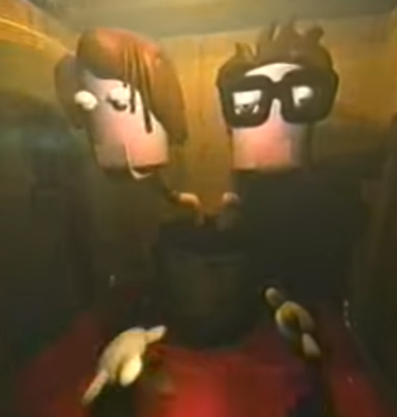 3D model of the 2-headed puppet in an arcade cabinet from the music video